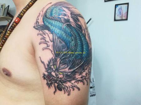 郑州金水区纹身:大臂纹身,龙纹身作品视频