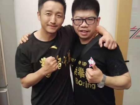 关教练与奥运冠军邹市明