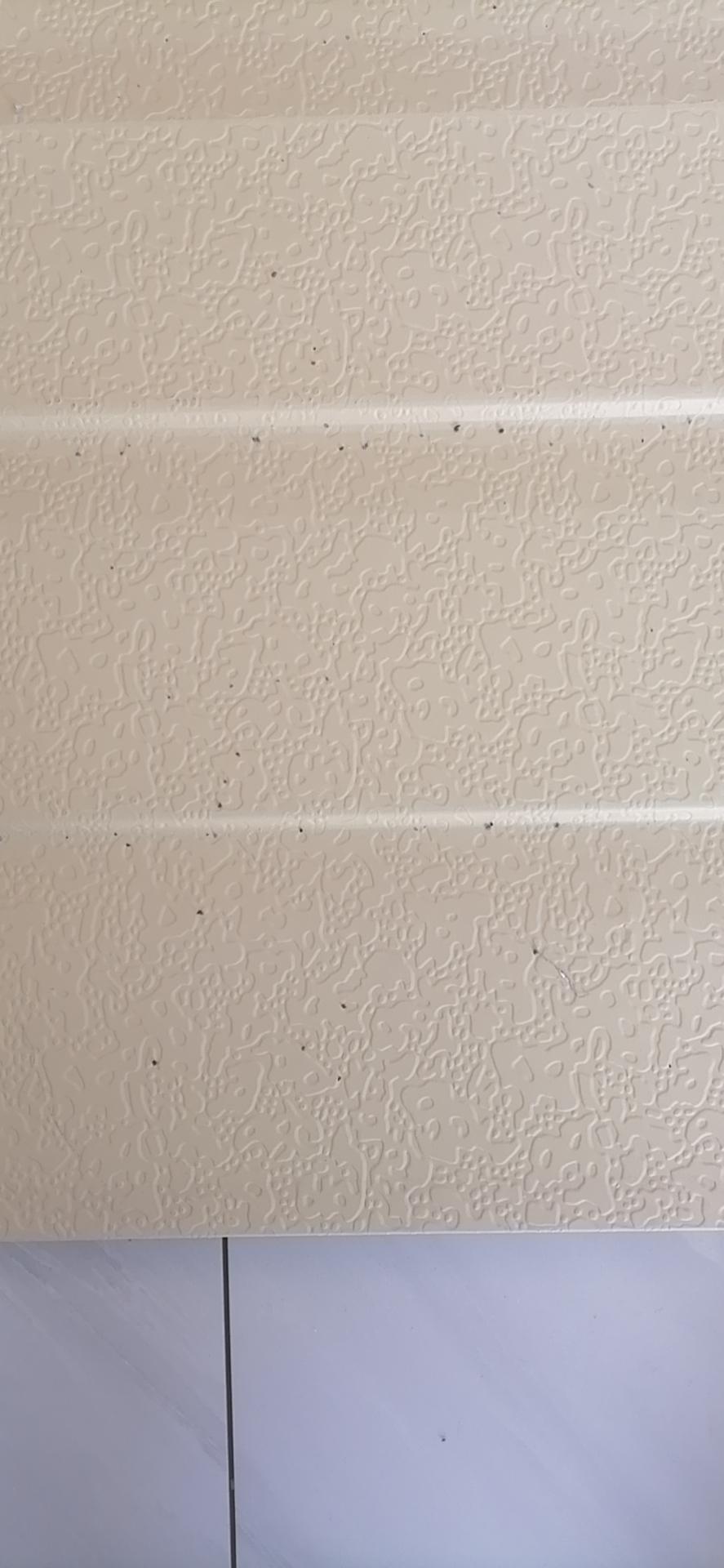 米黄弹涂双斜雕花板